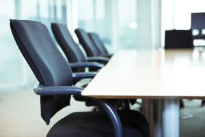 Empty chairs in a business boardroom. Very narrow depth of field shot with Tilt Shift.