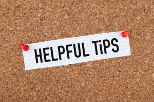 Helpful tips note paper pinned on cork bulletin board.