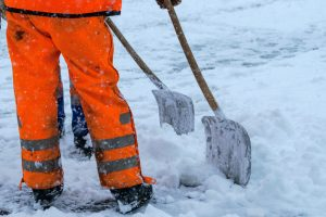 Equipment from worker who sweep snow from road in winter